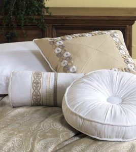 Aileen brings neutral to life with a pearlescent paisley design atop a flax-colored linen blend fabric. Decorative pillows are enhanced with fine details such as a double flange, ruching, ribbons, tufting, and embroidery. Hemstitching adds a unique touch to the duvet cover, bed skirt, throw pillows, table runner, and tambourine pillow.