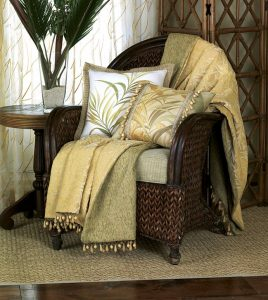 Transport yourself to an island haven with the beguiling Antigua. This tropical bed set features a palm motif complemented by multi-colored cord, gimp, tassels, and border. Wooden beaded trim accents several pillows. An embroidered sheer fabric, hand-painted throw pillows, and a storage chest create a unified effect.